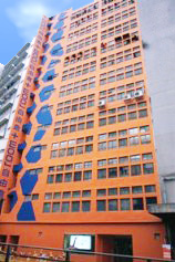 ROOM+ big orange and blue mini storage building